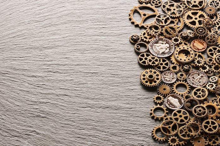 Various metal cogwheels with USA coins