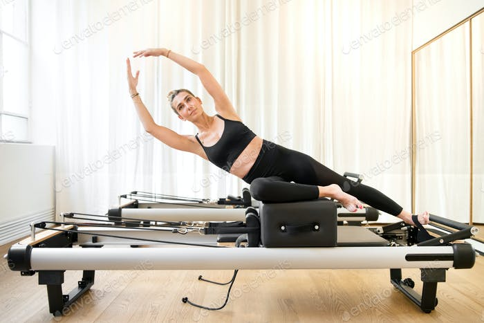 Woman performing a pilates yoga mermaid exercise