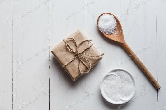 Healthy Sea Salt with giftbox on white wooden background