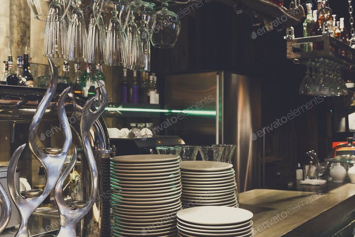 Bar counter with clean dishes close up