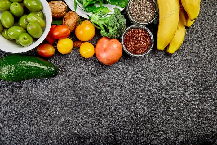 Selection of healthy food on dark background.