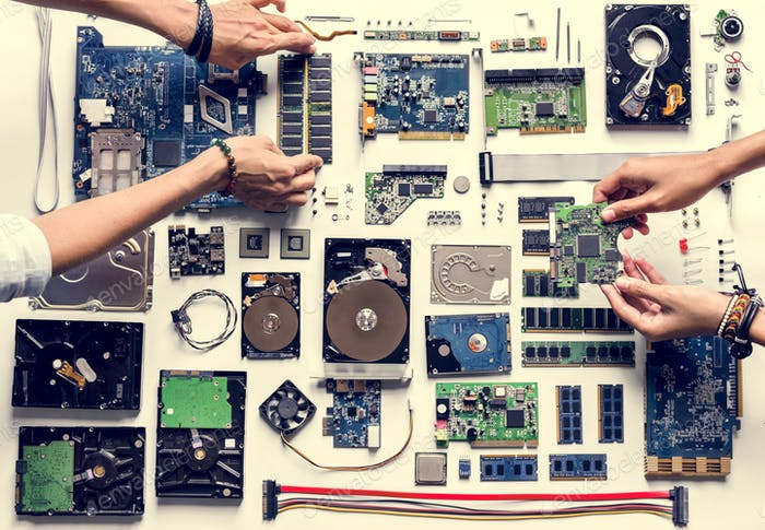 Aerial view of hands with computer electronics parts on white background