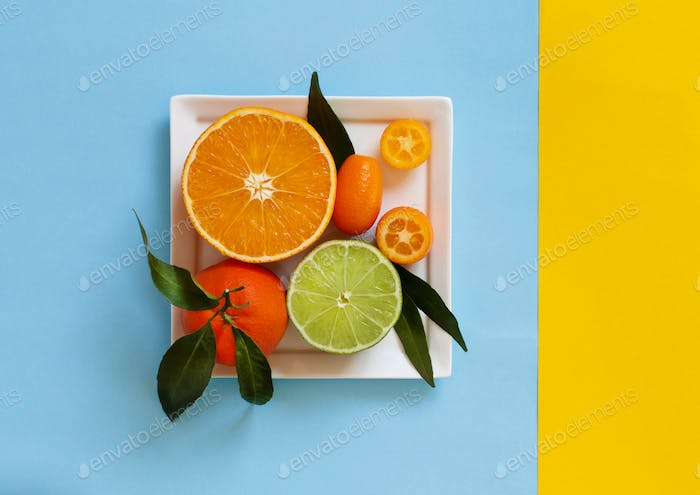 Citrus fruits on a blue and yellow background