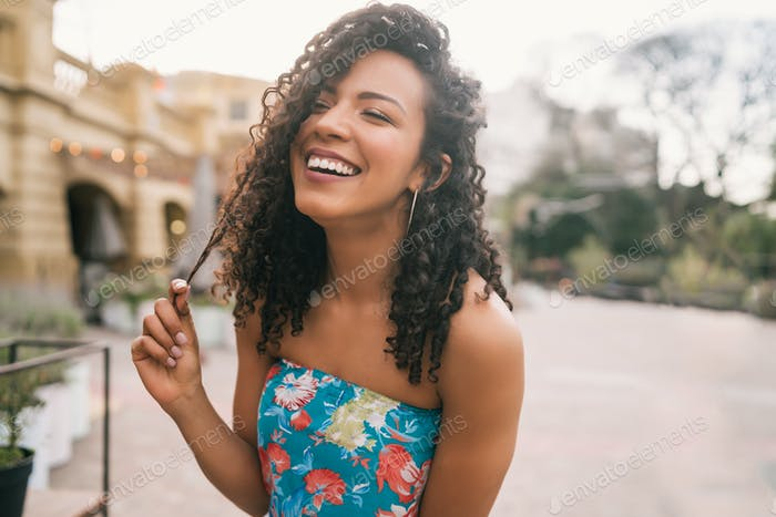 Portrait of confident woman laughing.