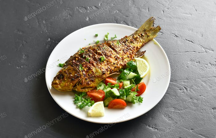 Roasted fish on plate