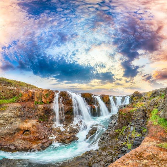 Breathtaking view of  Kolufossar waterfall at sunset.
