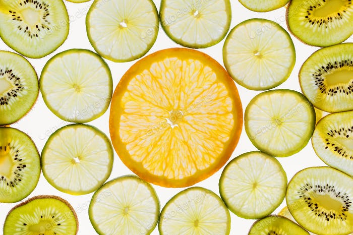 Fruit slices abstract pattern background, orange, limes and kiwi