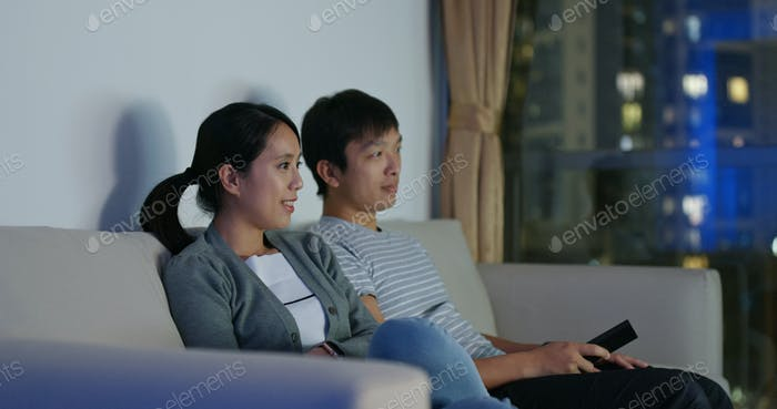Couple watch tv at home