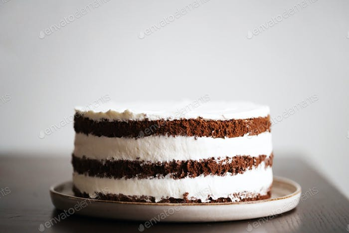Three Layers Chocolate Cake with Whipped Cream Filling.