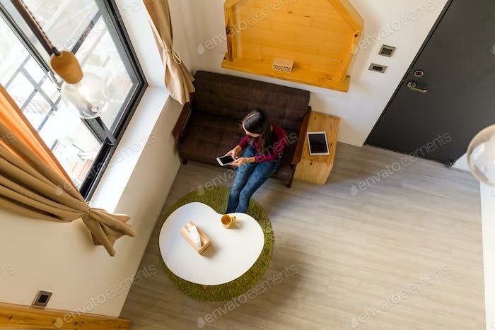 Top view of using cellphone woman