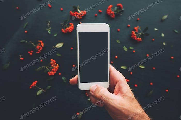 Hand using smartphone screen mock up