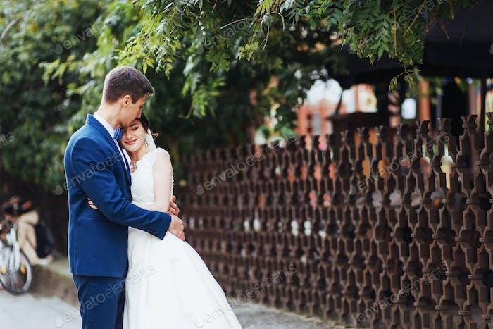 portrait of happy wedding couple outdoors.