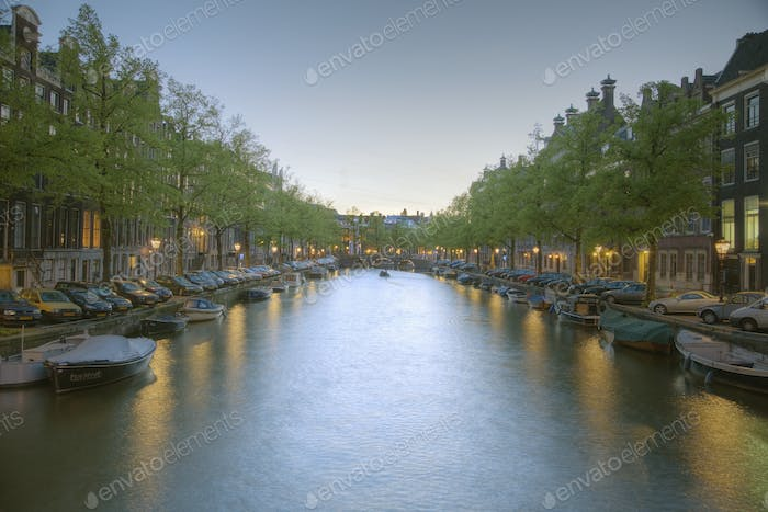 Boats in a Tree Lined Canal at Dusk