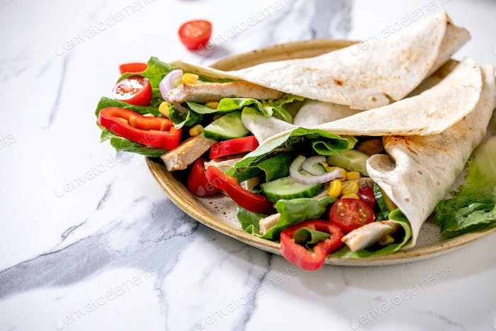 Traditional mexican tortila wrap with pork meat