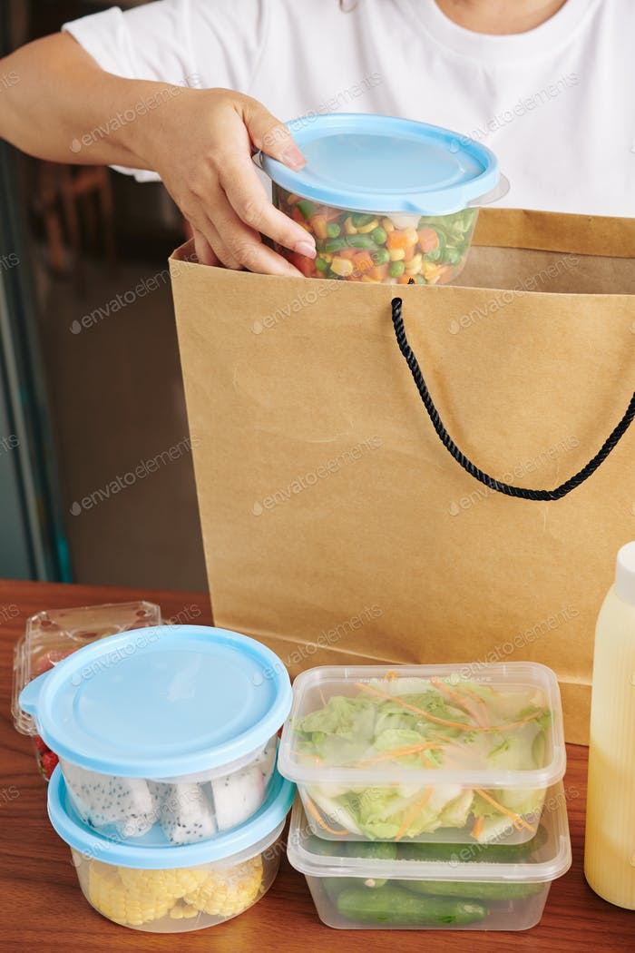Woman unpacking delivery bag