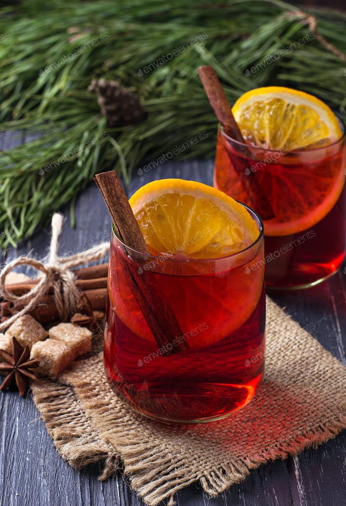 Glasses of mulled wine with orange and cinnamon