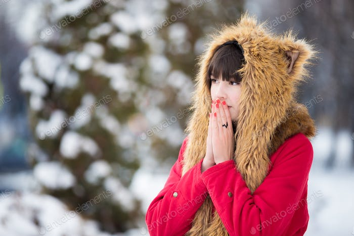 Woman shivering from cold outdoors in wintertime