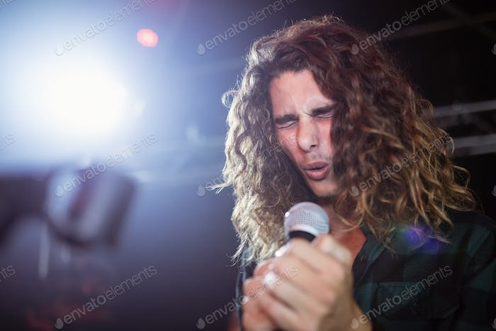 Young male singer performing at nightclub