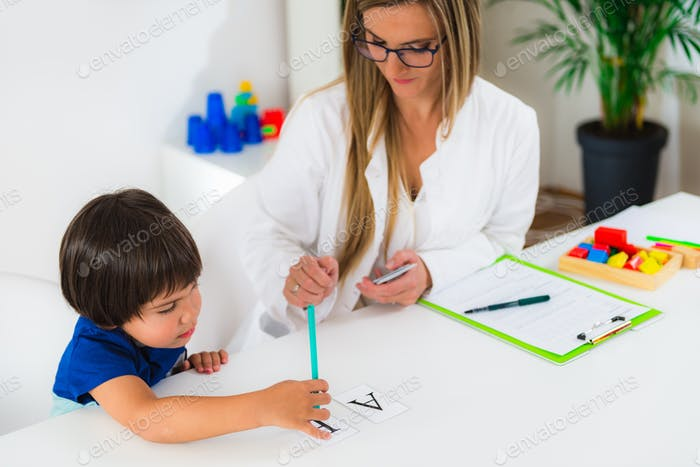 Child psychology, toddler doing logic tests with letters