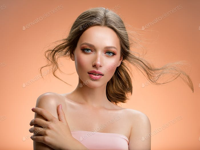 Portrait of a beautiful woman with a long hair.