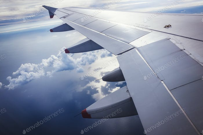 View from an aircraft window of an aeroplane wing, in flight.