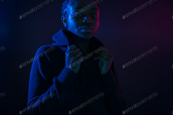 Colorful portrait of a woman with dark skin and cool attitude