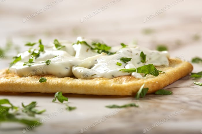 Salted cracker with cheese cream