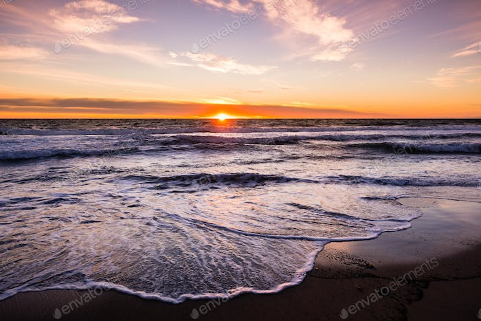 Sunset view of Malibu beach, the Pacific Ocean coastline, Los Angeles county, California