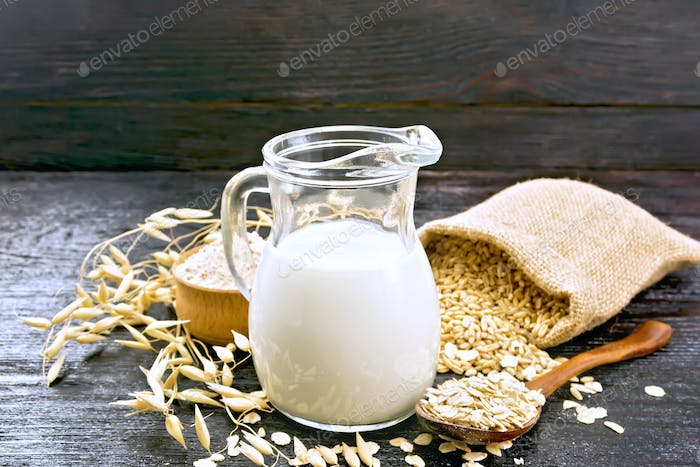 Milk oatmeal in jug on board