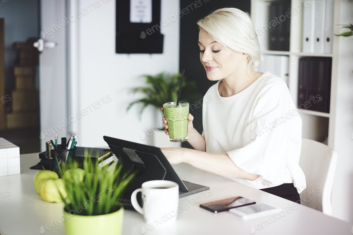 Businesswoman with digital tablet working at home