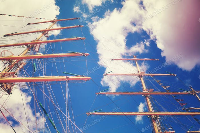 Vintage toned sailing vessel masts, looking up perspective