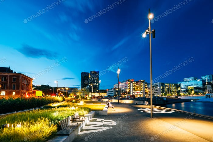 Night view of the city's waterfront, illuminated lanterns in the