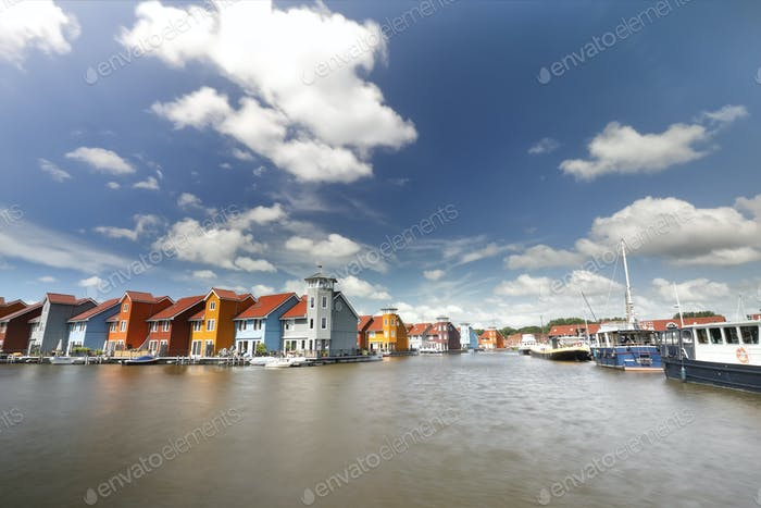 colorful buildings on water and ships  at harbor