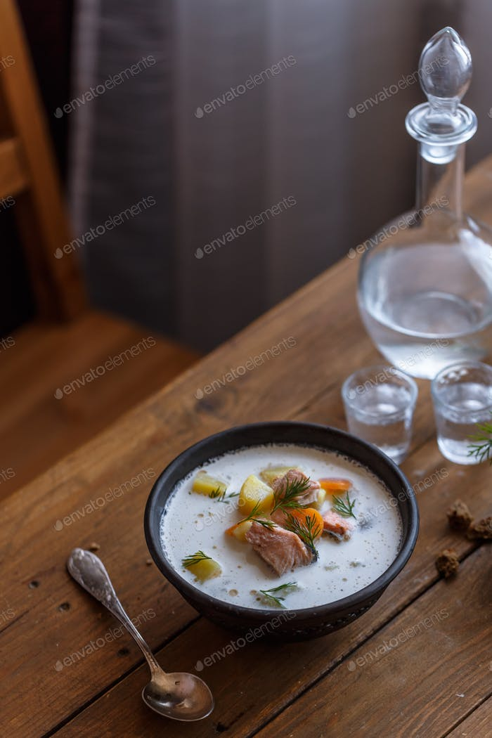 Traditional Finnish Salmon and cream soup - lohikeitto, selective focus