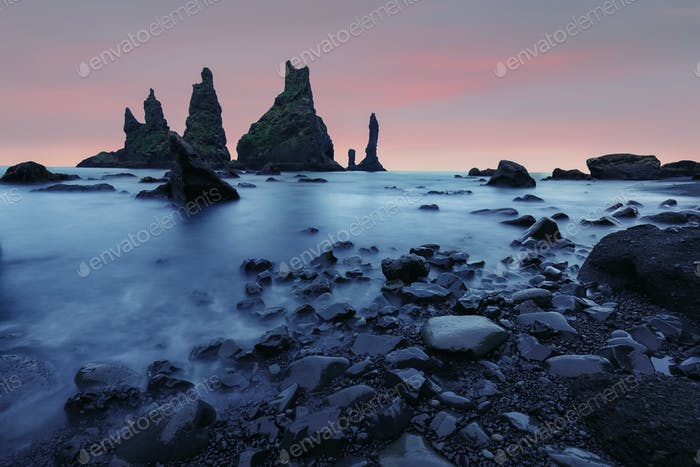 Amazing landscape with basalt rock formations Troll Toes on Black beach Reynisfjara