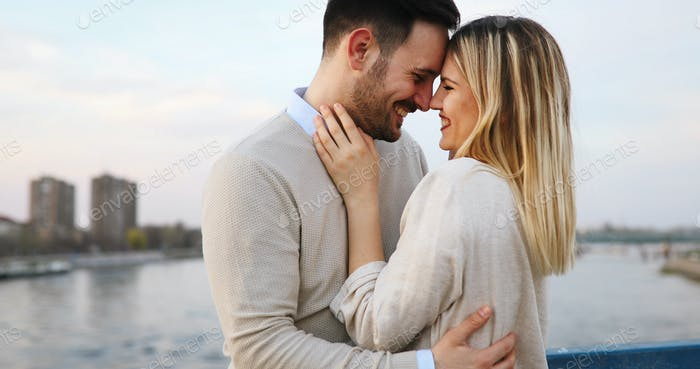 Couple kissing dating on bridge