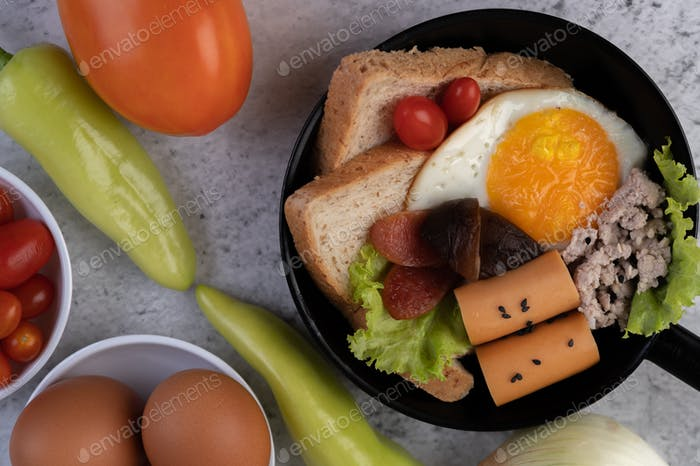 Vegetable salad with bread and boiled eggs in the pan.