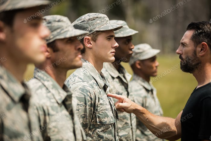 Trainer giving training to military soldier