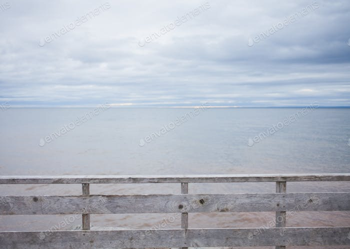 Wooden Fence and Ocean Background