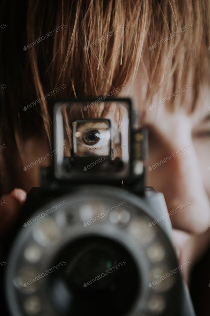 Woman's Eye in Viewfinder