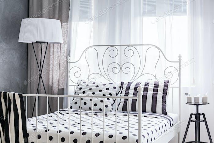 Modern designed bed in bedroom