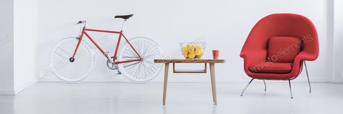 Red bike in stylish studio
