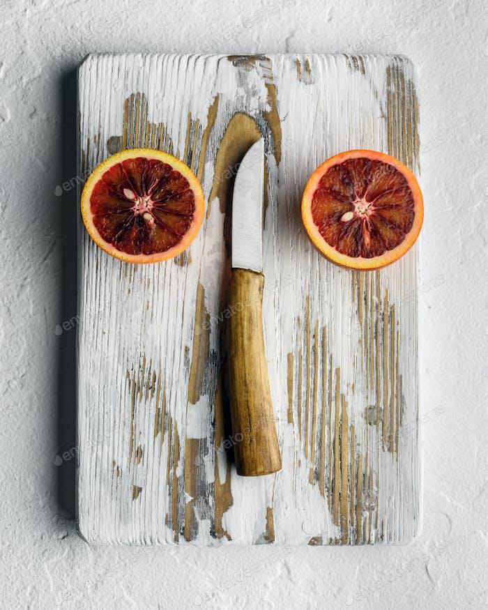 Orange pieces on wooden board closeup