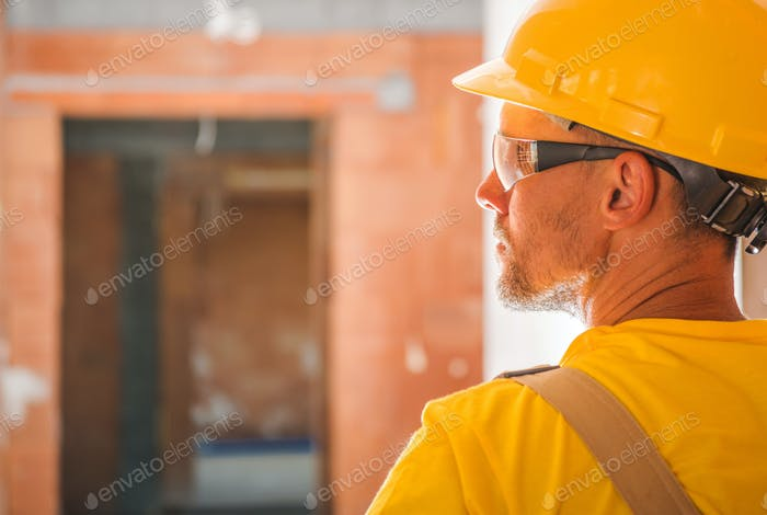 Yellow Uniform and Hard Hat Wearing Construction Worker