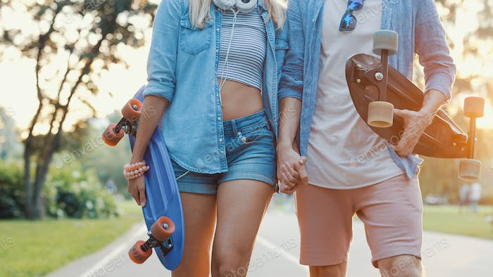 Smiling friends with skateboards