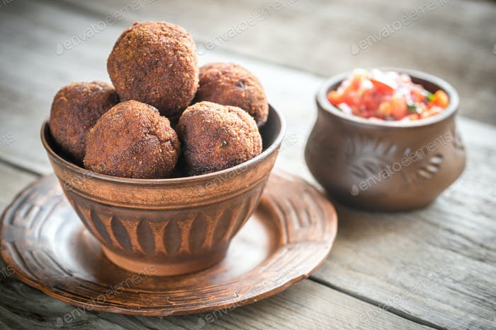 Bowl of meatballs with mexican sauce salsa