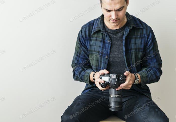 White man checking camera record