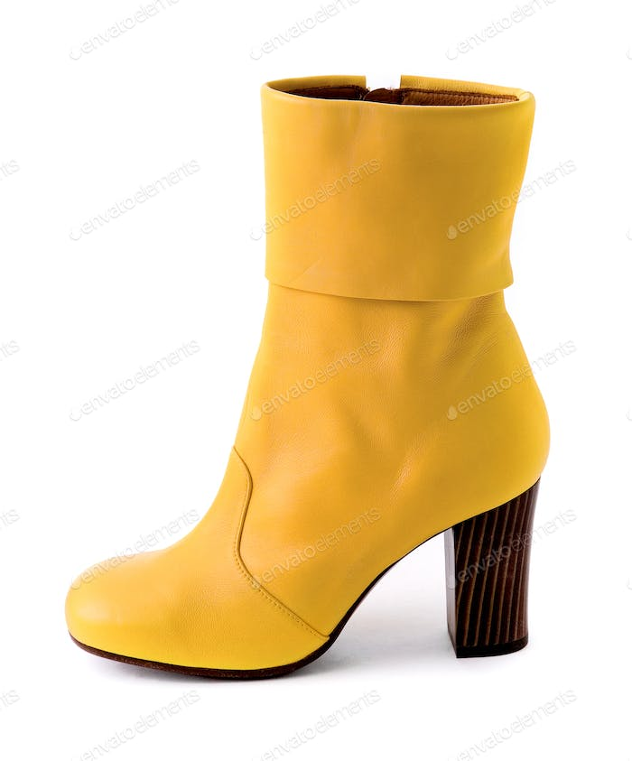 Elegant yellow leather boot with wooden heel
