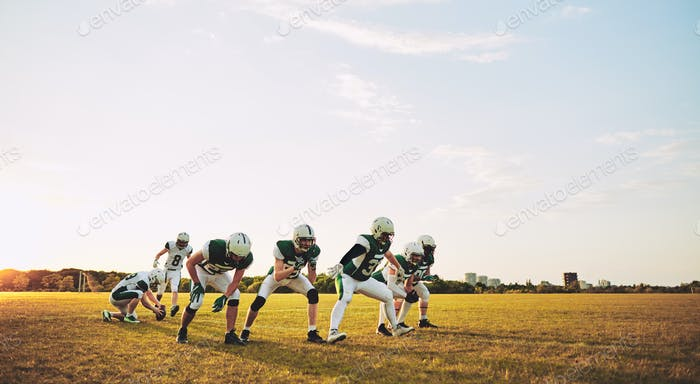 American football team doing place kicking drills during practice