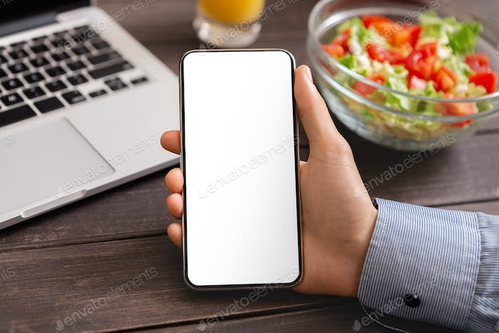 Modern smartphone with blank white screen in male hand, closeup